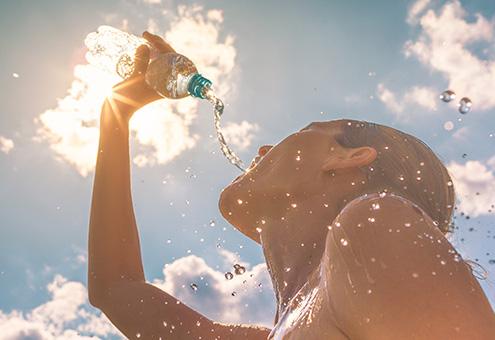 Women splashing water on her face