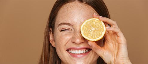 Women using citric acid fruit for her skin - R2 Medical Clinic