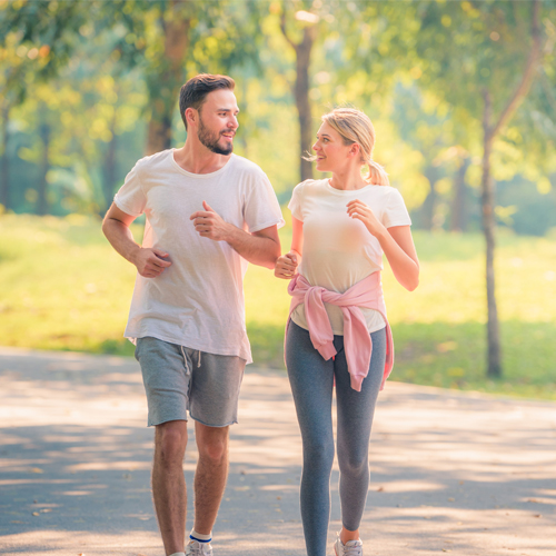 couple taking a light morning walk at Park